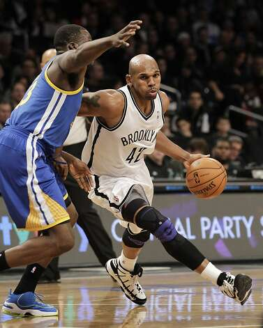 Brooklyn Nets forward Jerry Stackhouse (42) drives against Golden State Warriors forward Draymond Green (23) in the first half of their NBA basketball game at the Barclays Center, Friday, Dec. 7, 2012 in Brooklyn. (AP Photo/Kathy Willens) Photo: Kathy Willens, Associated Press