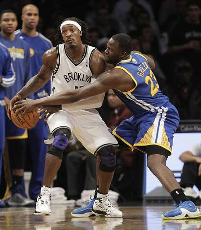 Golden State Warriors forward Draymond Green (23) defends Brooklyn Nets forward Gerald Wallace (45) in the second half of their NBA basketball game at the Barclays Center, Friday, Dec. 7, 2012, in New York. (AP Photo/Kathy Willens) Photo: Kathy Willens, Associated Press