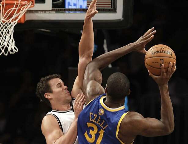 Brooklyn Nets forward Kris Humphries (43) defends against Golden State Warriors center Festus Ezeli (31) in the first half of their NBA basketball game at the Barclays Center, Friday, Dec. 7, 2012 in Brooklyn. (AP Photo/Kathy Willens) Photo: Kathy Willens, Associated Press