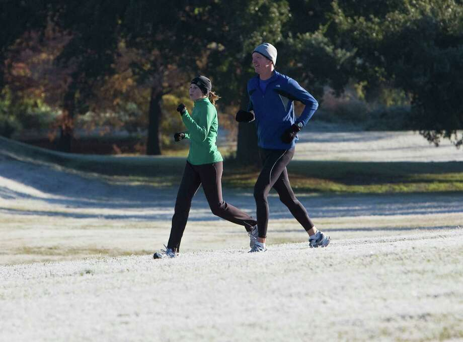 On Dec. 5, 2009, it was a frosty day in Houston for joggers along Buffalo Bayou. There might not be many chilly times this year or in 2013 for the U.S., which could hurt the natural gas industry. Photo: James Nielsen, Staff / Houston Chronicle