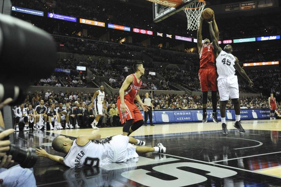 DeJuan Blair (45) of the San Antonio Spurs battles Marcus Morris of the Houston Rockets for a rebound as Jeremy Lin of the Rockets (7) watches and Tony Parker (9) of the Spurs lies the floor during NBA action at the AT&T Center on Friday, Dec. 7, 2012. Parker had shot and missed a layup. (Billy Calzada / San Antonio Express-News)