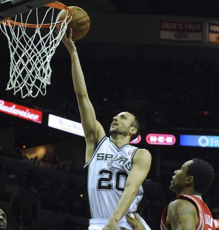 Manu Ginobili of the San Antonio Spurs hits a layup during first-half action against the Houston Rockets at the AT&T Center on Friday, Dec. 7, 2012. (Billy Calzada / San Antonio Express-News)