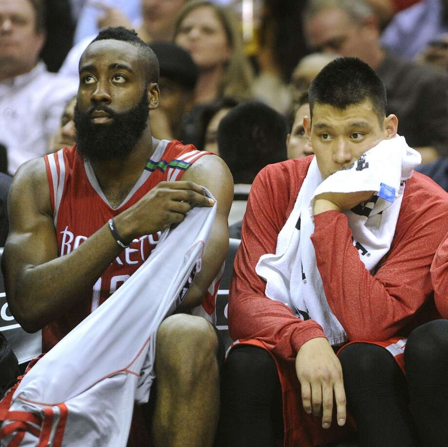 James Harden and Jeremy Lin of the Houston Rockets watch from the bench as the game winds down on their 114-92 loss to the San Antonio Spurs at the AT&T Center on Friday, Dec. 7, 2012. (Billy Calzada / San Antonio Express-News)