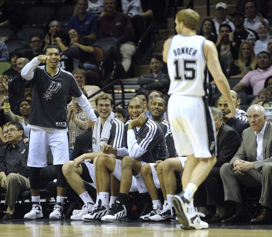 Danny Green, left, Tiago Splitter, Tim Duncan and Boris Diaw of the San Antonio Spurs react after Matt Bonner, (15) dunked the ball against the Houston Rockets during second-half NBA action at the AT&T Center on Friday, Dec. 7, 2012. (Billy Calzada / San Antonio Express-News)