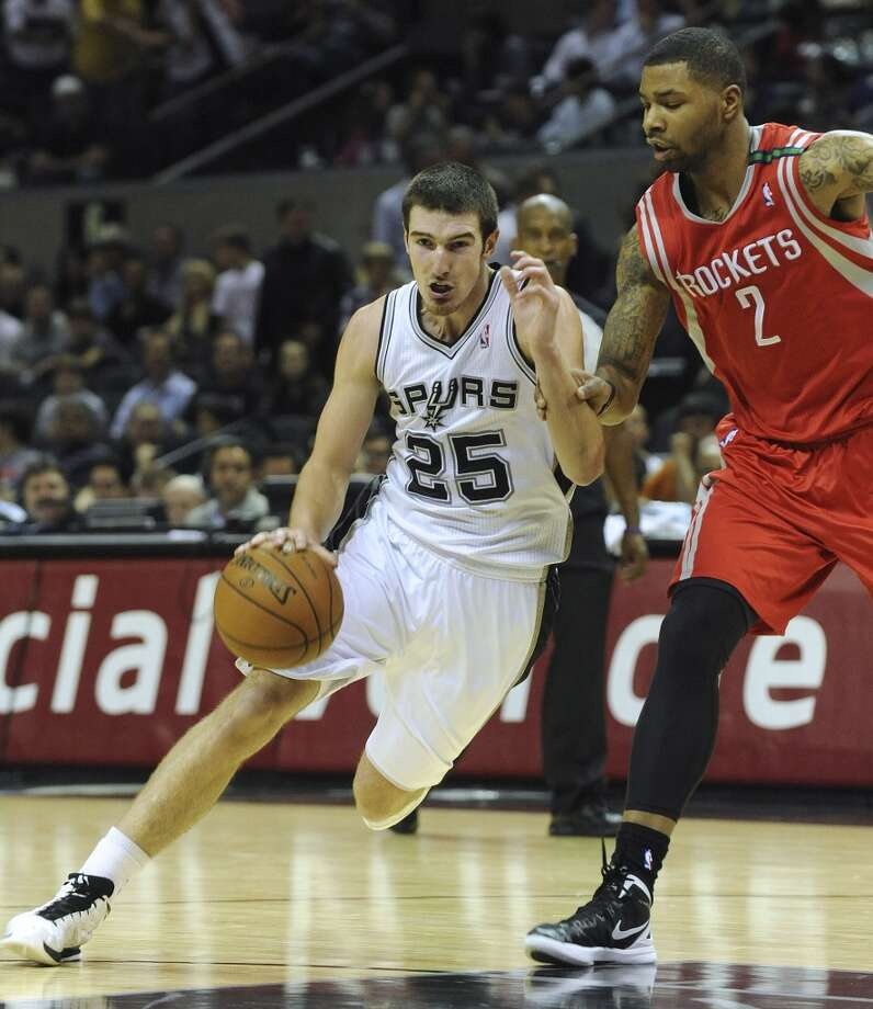Nando De Colo of the Spurs (25) drives past Marcus Morris of the Houston Rockets in NBA action at the AT&T Center on Friday, Dec. 7, 2012. (Billy Calzada / San Antonio Express-News)