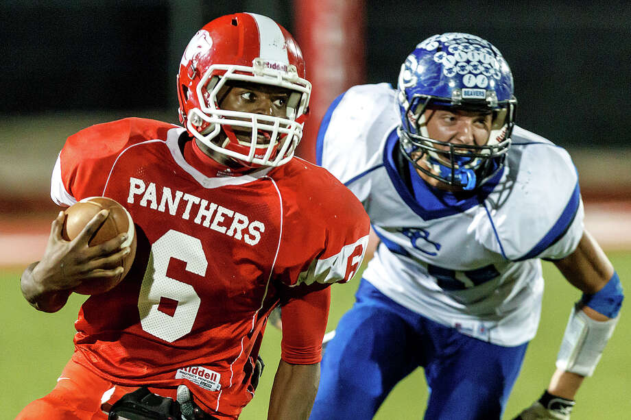 Burton's Juwan Mathis (left) turns upfield with Falls City's Dylan Cheatham in pursuit during the fourth quarter of their Class A Division II state quarterfinal game at Rutledge Stadium on Dec. 7, 2012.  Falls city beat the Panthers 29-7.  MARVIN PFEIFFER/ mpfeiffer@express-news.net Photo: MARVIN PFEIFFER, For The Express-News / Express-News 2012
