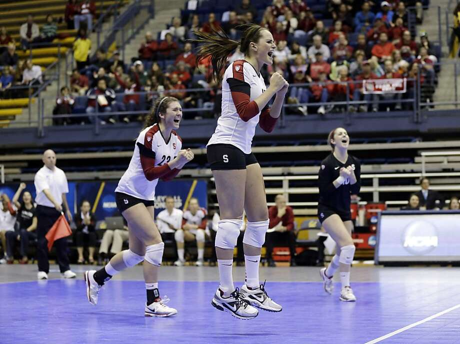 Jordan Burgess (left), who led Stanford with 16 kills, celebrates with teammates Karissa Cook and Kyle Gilbert during the Cardinal's 25-16, 25-19, 25-17 win over Iowa State in the NCAA round of 16 at Cal's Haas Pavilion on Friday night. Stanford will play Michigan for a Final Four spot at 8:30 p.m. Saturday at Cal. Photo: Marcio Jose Sanchez, Associated Press