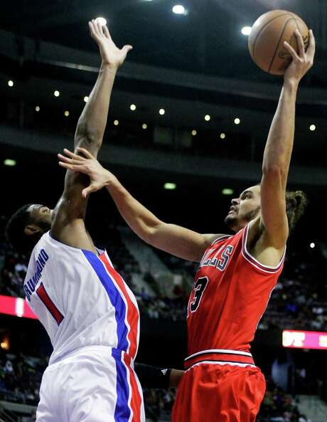 Bulls center Joakim Noah, right, goes to the basket against Pistons forward Andre Drummond en route to scoring a career-high 30 points. Photo: Duane Burleson, FRE / FR38952 AP