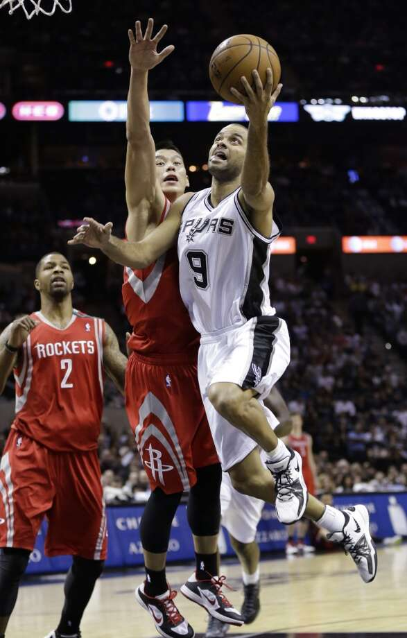 Dec. 7: Spurs 114, Rockets 92Spurs point guard Tony Parker attempts a shot over Rockets point guard Jeremy Lin. (Eric Gay / Associated Press)