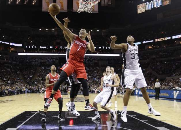 Rockets point guard Jeremy Lin attempts a layup versus the Spurs' defense. (Eric Gay / Associated Press)