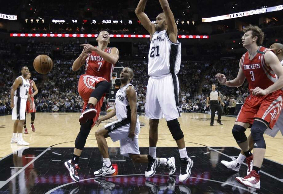 Rockets point guard Jeremy Lin loses the handle while driving against the Spurs. (Eric Gay / Associated Press)
