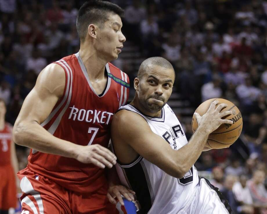 Spurs point guard Tony Parker is defended by Rockets point guard Jeremy Lin. (Eric Gay / Associated Press)