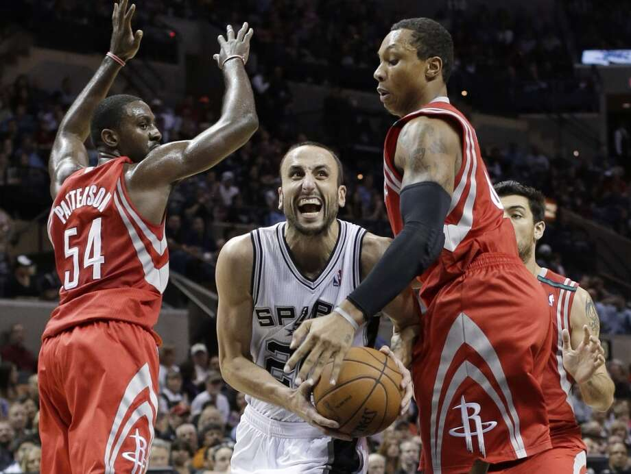 Spurs guard Manu Ginobili drives past Patrick Patterson and Greg Smith of the Rockets.  (Eric Gay / Associated Press)