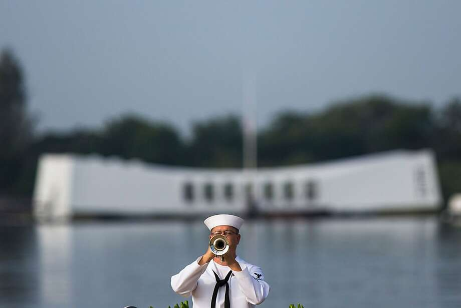 "PEARL HARBOR, HAWAII - DECEMBER 7:   A U.S. Navy musician plays echo ""Taps"" in front of the U.S.S. Arizona Memorial during the 71st Annual Memorial Ceremony commemorating the WWII Attack On Pearl Harbor at the World War 2 Valor in the Pacific National Monument December 7, 2012 in Pearl Harbor, Hawaii. This is the 71st anniversary of the Japanese attack on Pearl Harbor.  (Photo by Kent Nishimura/Getty Images) Photo: Kent Nishimura, Getty Images"