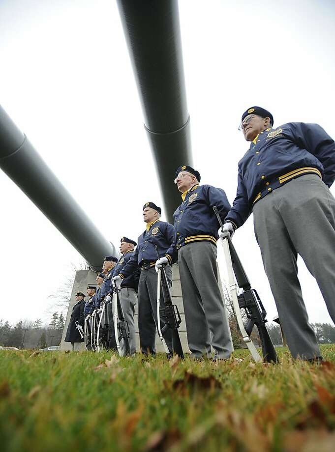 The State College American Legion Post 245 honor guard stands at attention during a Pearl Harbor Remembrance Day and ceremony at the Pennsylvania Military Museum, in Boalsburg, Pa., Friday, Dec. 7, 2012 is   (AP Photo/Centre Daily Times, Centre Daily Times) Photo: Nabil K. Mark, Associated Press