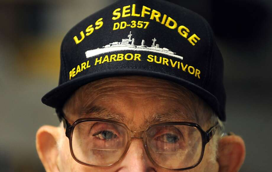 James Metcalf, of the U.S Navy, listens during the Pearl Harbor remembrance ceremony at Northwest Louisiana War Veterans Home in Bossier City, La. on Friday, Dec. 7, 2012.   Metcalf, was aboard the USS Selfridge during the attack on Pearl Harbor, Dec. 7, 1941.  (AP Photo/The Shreveport Times, Jim Hudelson ) MAGS OUT; MANDATORY CREDIT SHREVEPORTTIMES.COM;  NO SALES Photo: Jim Hudelson, Associated Press