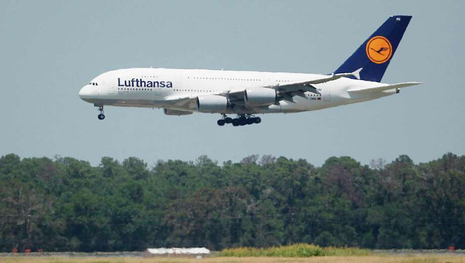A Lufthansa A380 arrives during its first flight to Bush Intercontinental Airport on Aug. 1. IAH plans to be ready when other airlines want bring in their A380s. Photo: Mayra Beltran, Staff / © 2012 Houston Chronicle