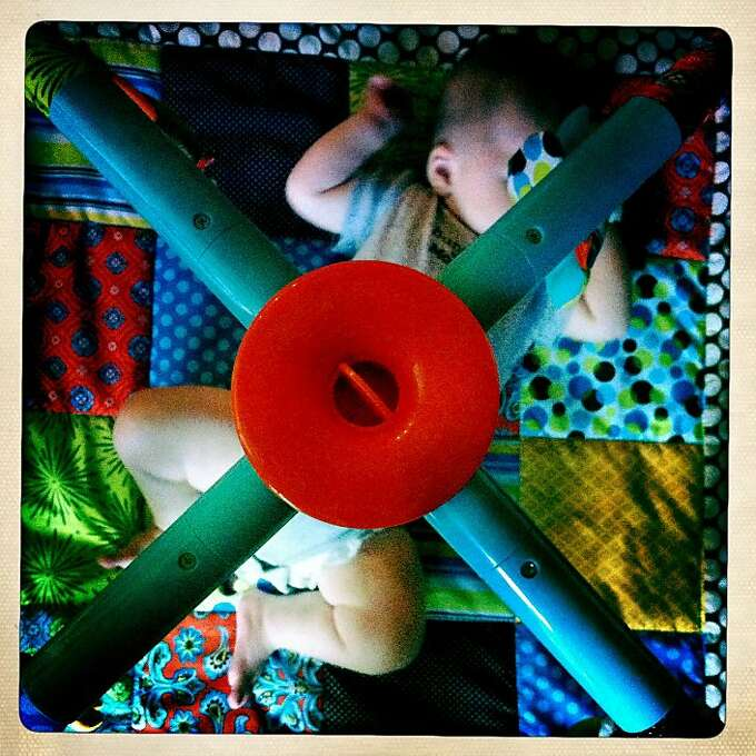 Quinn would play on his play gym, and would often fall asleep. This is another fun square frame to shoot. Photo: Jamie Cotten