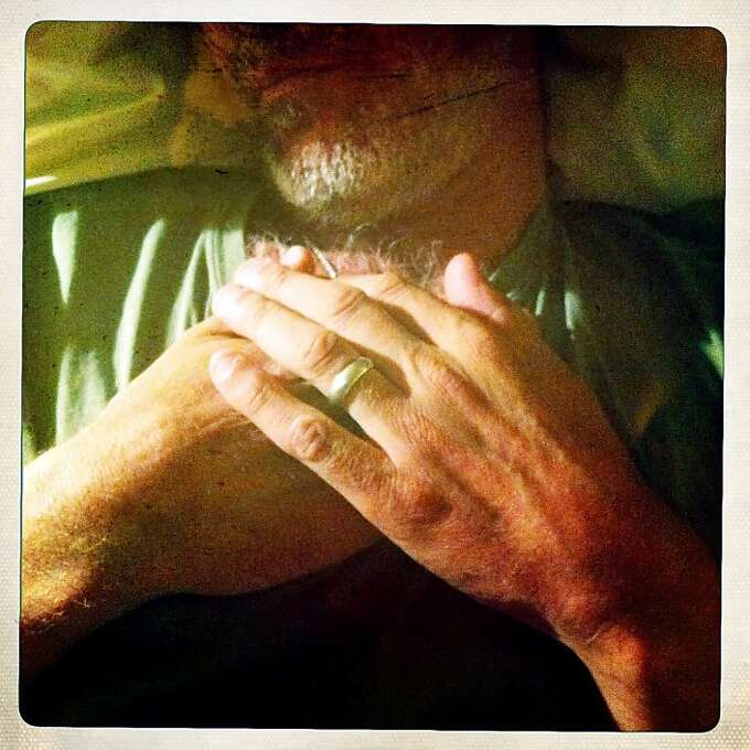 Craig rests his hands on his chest before bed. He does this a lot, and to me it's a symbol of his strong values - loyalty, dedication and family. Photo: Jamie Cotten