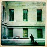 A lone trumpeter plays some tunes as he sits on a side street near The San Francisco Chronicle building.