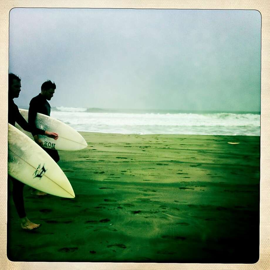 Surfers walk down a cold beach, four blocks from Judy's house in San Francisco. Photo: Jamie Cotten
