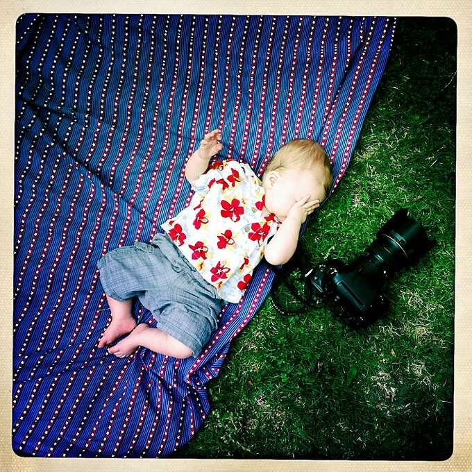 Quinn wakes up near Craig's camera on the ground at a friend's house during a barbecue. Photo: Jamie Cotten