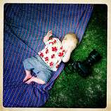 Quinn wakes up near Craig's camera on the ground at a friend's house during a barbecue.