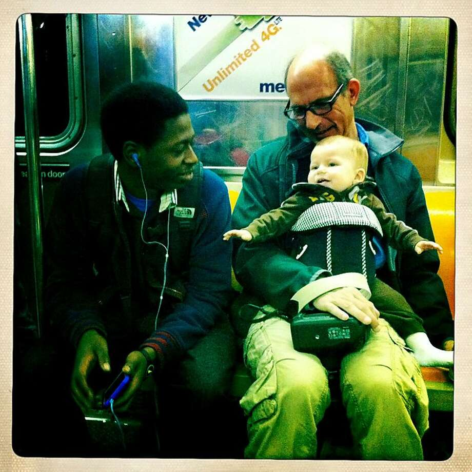 Quinn picked up friends everywhere we went. This is on the 1 Train in NYC, headed downtown to see the 9/11 Memorial. Photo: Jamie Cotten