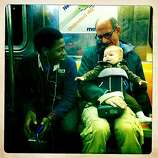 Quinn picked up friends everywhere we went. This is on the 1 Train in NYC, headed downtown to see the 9/11 Memorial.