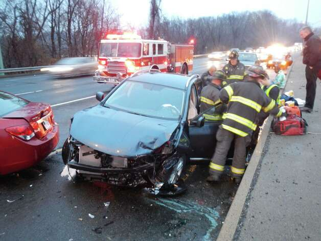 Danbury Firefighters and EMS work to assist victim of crash on Interstate 84 Saturday morning at 7am. Photo: Contributed Photo / Connecticut Post Contributed
