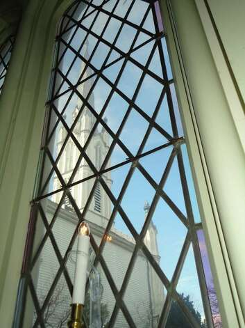 The steeple of Trinity Episcopal Church as seen through a window in the parish hall.  Fairfield CT 12/5/12 Photo: Meg Barone / Fairfield Citizen freelance