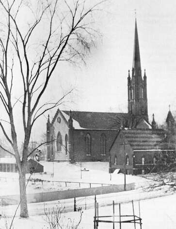 Trinity Episcopal Church, in a snow-covered landscape in 1872, a decade after the existing sanctuary was built.  Fairfield CT 12/5/12 Photo: Contributed Photo / Fairfield Citizen contributed