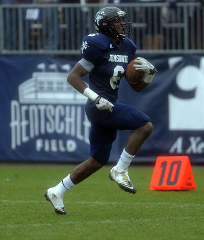 Ansonia's Raeshaun Finney scores a goal on a 75-yard touchdown reception during the Class S state football championship game against North Branford Saturday, Dec. 8, 2012 at Rentschler Field in East Hartford, Conn. Photo: Autumn Driscoll / Connecticut Post