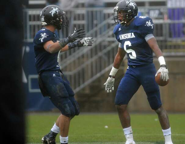Ansonia's Raeshaun Finney, right, celebrates his 75-yard touchdown reception during the Class S state football championship game against North Branford Saturday, Dec. 8, 2012 at Rentschler Field in East Hartford, Conn. Photo: Autumn Driscoll / Connecticut Post