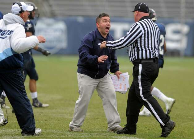 Ansonia coach Thomas Brockett argues a call during the Class S state football championship game against North Branford High School Saturday, Dec. 8, 2012 at Rentschler Field in East Hartford, Conn. Photo: Autumn Driscoll / Connecticut Post