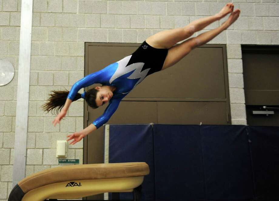Staples' gymnast Anna Violette competes on vault Wednesday, Jan. 18, 2012 during a meet with Newtown and Oxford at Weston Middle School. Photo: Autumn Driscoll / Connecticut Post