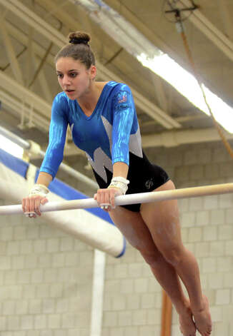 Staples' Anna Violet competes on the uneven bars during the gymnastics meet against Greenwich, Weston, and Joel Barlow, at Weston Middle School gymnasium on Thursday, Dec. 22, 2011. Photo: Amy Mortensen / Connecticut Post Freelance