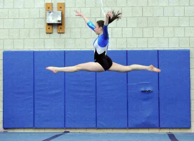 Staples' Deanna Baris performs her floor routine during their gymnastics meet with Darien at Weston Middle School Tuesday, Feb. 7, 2012. Photo: Autumn Driscoll / Connecticut Post