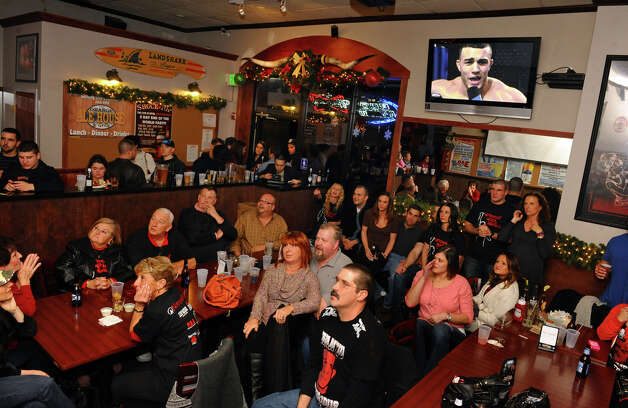 Family and friends gather to watch Nick Newell fight for the MMA Lightweight Championship in Nashville, Tenn. which was televised live at Orange Ale House in Orange, Conn. on Friday December 7, 2012. Photo: Christian Abraham / Connecticut Post