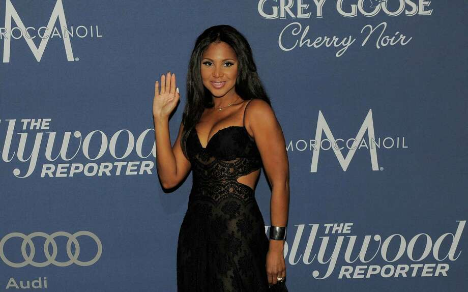 FILE - In this Feb. 23, 2012 file photo, singer Toni Braxton arrives at The Hollywood Reporter Nominees Night, at Mayor Antonio Villaraigosa's official residence in Los Angeles.  Braxton has been hospitalized in Los Angeles for health issues caused by Lupus. (AP Photo/Chris Pizzello, File) Photo: Chris Pizzello