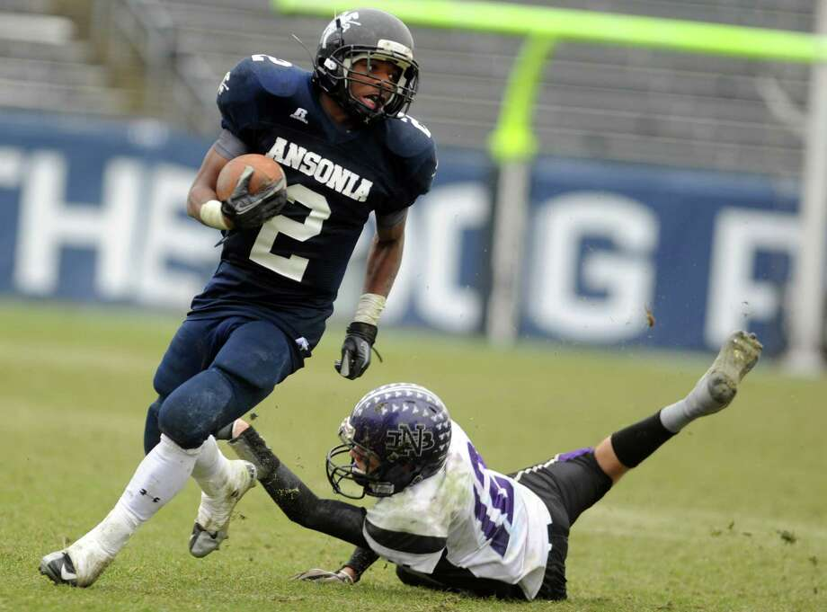 Ansonia's Arkeel Newsome fends off North Branford's Alex McGuigan during the Class S state football championship game Saturday, Dec. 8, 2012 at Rentschler Field in East Hartford, Conn. Photo: Autumn Driscoll / Connecticut Post