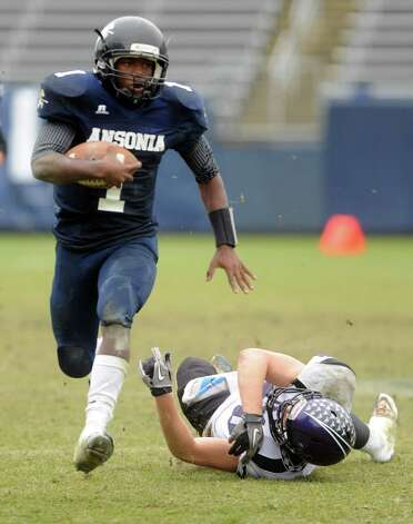 Ansonia's Jaiquan McKnight carries the ball during the Class S state football championship game against North Branford Saturday, Dec. 8, 2012 at Rentschler Field in East Hartford, Conn. Photo: Autumn Driscoll / Connecticut Post