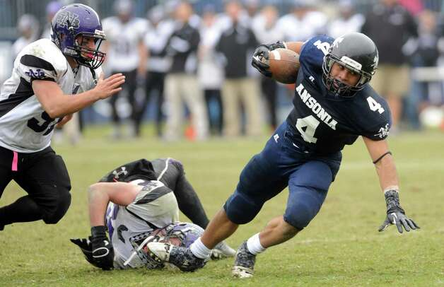Ansonia's Andrew Matos lunges to the four-yard line just before a touchdown during the Class S state football championship game against North Branford Saturday, Dec. 8, 2012 at Rentschler Field in East Hartford, Conn. Photo: Autumn Driscoll / Connecticut Post