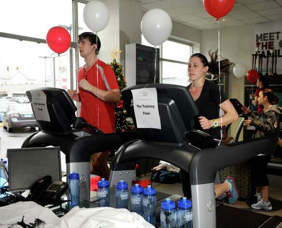 Whitney Franklin of Team Toyota runs on a treadmill as part of Team Toyota as she participates in a charity event that is a collaboration between Family CentersâÄô Associate Board and Toyota of Stamford to benefit a Stamford family in need on Saturday, December 8, 2012. Photo: Lindsay Niegelberg / Stamford Advocate