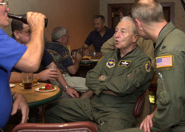 "Ralph Parr (center) is a Korean War ace. He is seen Friday, July 25, 2003, at the Officers Club at Randolph AFB where a party was thrown in his honor and attendees were encouraged to ask him to tell ""old war stories."" Photo: Express-News File Photo / SAN ANTONIO EXPRESS-NEWS"