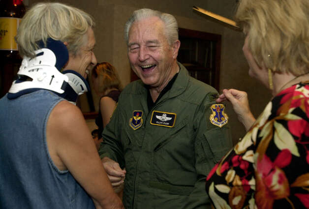 "Ralph Parr is a Korean War ace. He is seen Friday, July 25, 2003, at the Officers Club at Randolph Air Force Base. He laughs with Carole Thompson (left), a fellow member of the ""River Rats"" -- the Red River Valley Fighter Pilots Association -- and friend Mary Reynolds during a party thrown in his honor. The party comes at an appropriate moment -- the 50th anniversary of the end of the Korean War is this weekend. (KAREN L. SHAW/STAFF) Photo: KAREN L. SHAW, SAN ANTONIO EXPRESS-NEWS / SAN ANTONIO EXPRESS-NEWS"