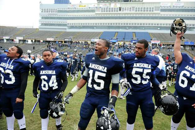 Ansonia celebrates their 59 to 26 win over North Branford High School during the Class S state football championship game Saturday, Dec. 8, 2012 at Rentschler Field in East Hartford, Conn. Photo: Autumn Driscoll / Connecticut Post