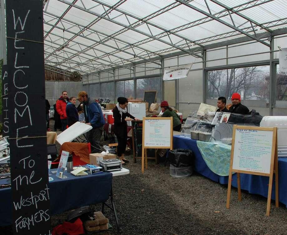 The Westport Farmers Market moved to its winter quarters Saturday at Gilbertie's Herb Garden on Sylvan Lane.  Westport CT 12/8/12 Photo: Jarret Liotta / Westport News contributed