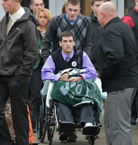 Shen student Matt Hardy center, leaves Corpus Christi Church in Round Lake Saturday Dec. 8, 2012, following funeral services for Chris Stewart, the 17-year-old Shenendehowa student who died along with classmate Deanna Rivers in a crash on the Northway that left two other teens injured. Hardy was one of the teens seriously injured in the crash.  (John Carl D'Annibale / Times Union) Photo: John Carl D'Annibale / 00020394A