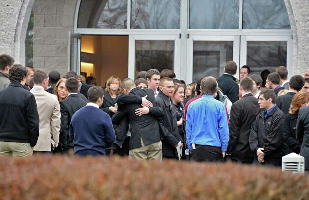 Mourners outside Corpus Christi Church in Round Lake Saturday Dec. 8, 2012, following funeral services for Chris Stewart, the 17-year-old Shenendehowa student who died along with classmate Deanna Rivers in a crash on the Northway that left two other teens injured.    (John Carl D'Annibale / Times Union) Photo: John Carl D'Annibale / 00020394A